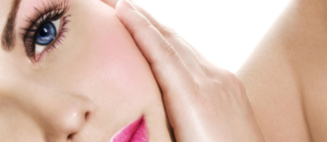 Closeup of woman laying on her side with hand on her cheek